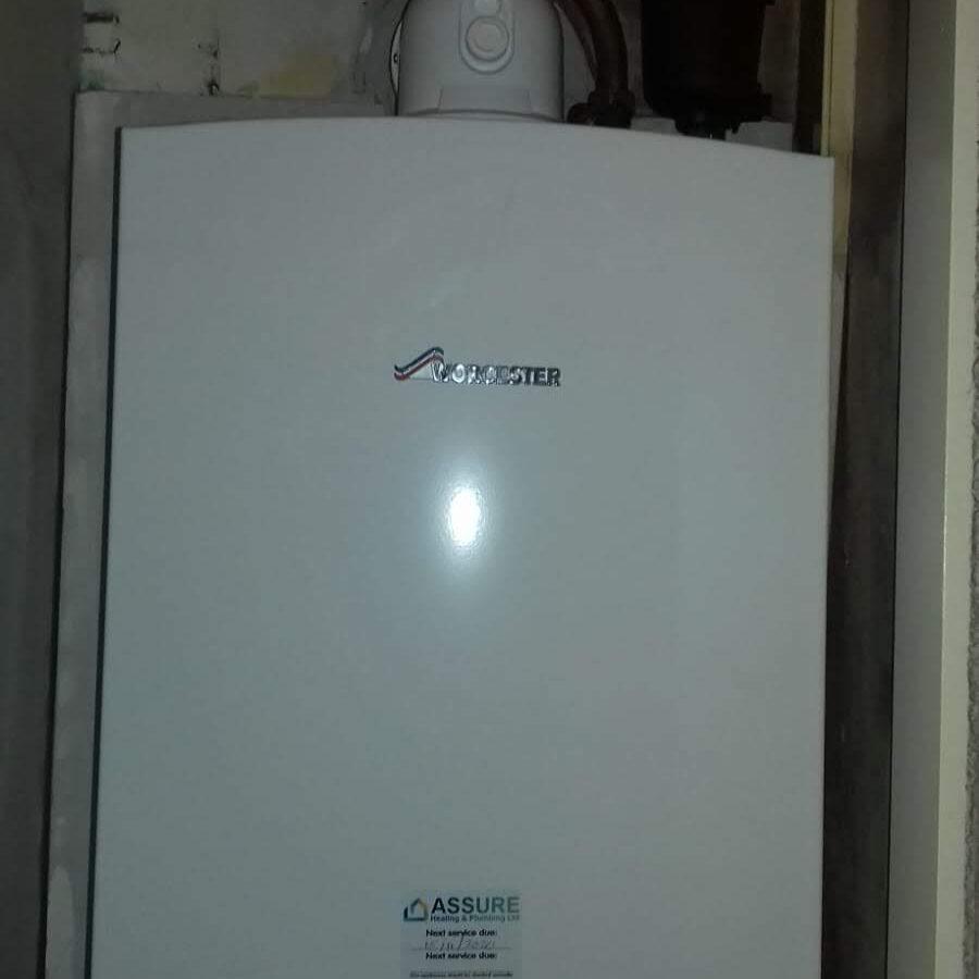 Assure Heating installing a Worcester Combi Boiler